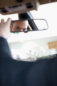 bigstock-Man-adjusting-a-rear-view-mirr-34979918