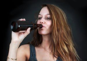 bigstock-Drunk-Woman-Drinking-Beer-Over-45072763