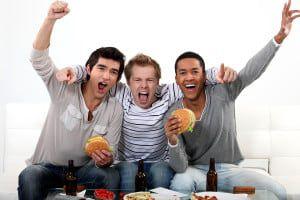 bigstock-Friends-watching-a-football-ga-50087642