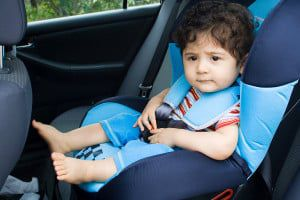 bigstock-toddler-boy-sitting-in-car-sea-14761151